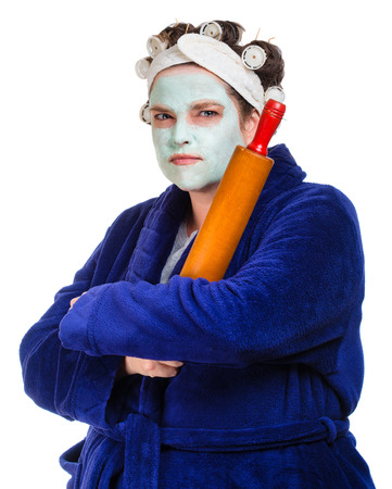 ugly mouth: Mean and ugly housewife with facial mask, hair rollers and rolling pin isolated on white