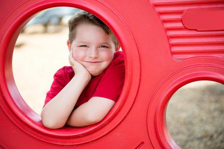 Portrait of young child playing on playground 版權商用圖片 - 29044177