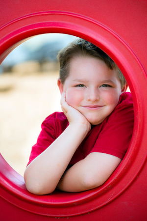 Portrait of young child playing on playground 版權商用圖片 - 29044178