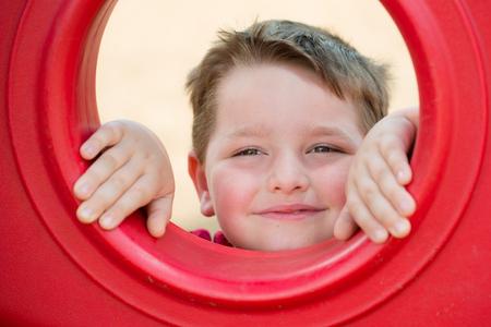 Portrait of young child playing on playground 版權商用圖片 - 29044179