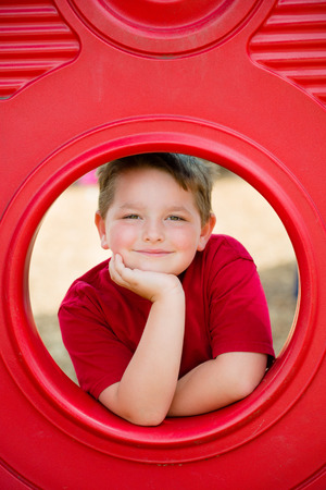 Portrait of young child playing on playground