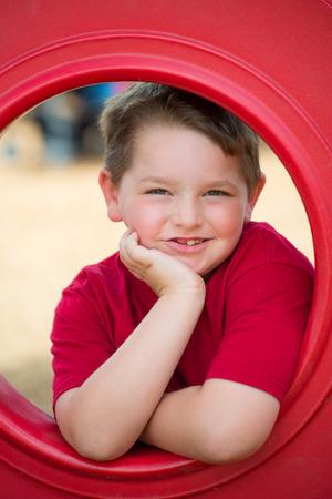 Portrait of young child playing on playground 版權商用圖片 - 29044184