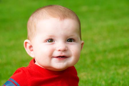 Smiling happy cute baby outdoors 版權商用圖片