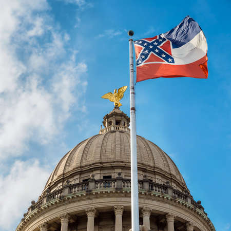 lawmaking: Mississippi state flag flying in front of capitol building in Jackson