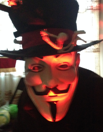 occupy movement: Red Anonymous masked man with black top hat with skeletons on it.