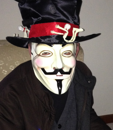 vendetta: Anonymous masked man with black top hat with skeletons on it.