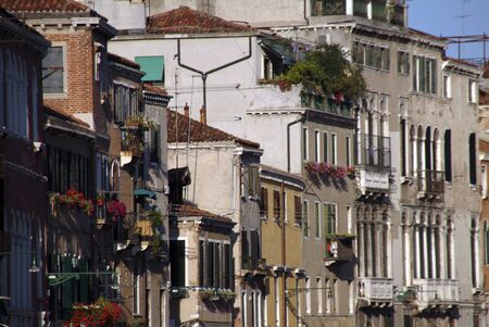 A row of canalside houses in Venice, Italy photo