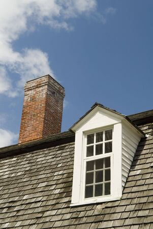 dormer: Close Up of A Dormer Window and Chimney