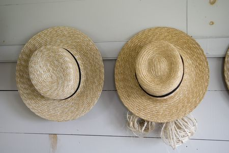 quaker: Close Up Of Two Straw Hats Hanging on the wall Stock Photo