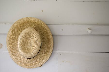 quaker: Close Up of A Straw Hat Hung On the wall Stock Photo