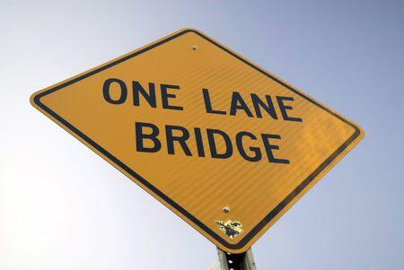 one lane sign: One Lane Bridge Sign near a Covered Bridge