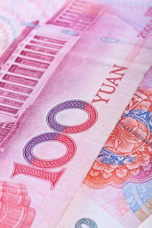 Cropped close-up of Chinese RMB banknotes with limited DOF photo