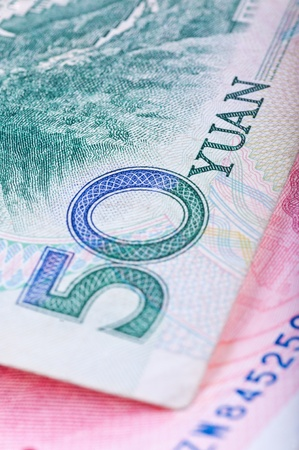 number 50: Cropped close-up of Chinese RMB banknotes with limited DOF Stock Photo