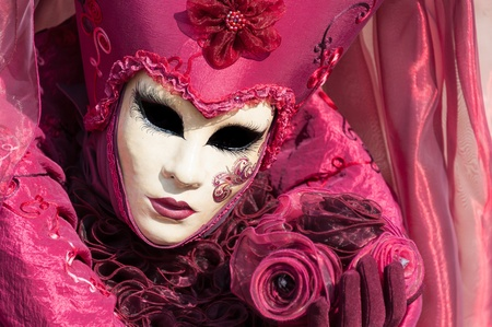 Beautiful coloured image of the fantastic costumes on display on the streets of Venice during carnival photo