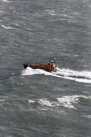 seas: ENGLISH CHANNEL NEAR PORTLAND, DORSET, UK, 27 OCTOBER 2013: RNLI lifeboat in heavy seas