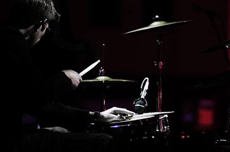drum sticks: Shot of a drummer on live concert. Artistic look Stock Photo