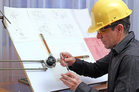 architect office: The quality dimensional inspectorengineer checking metal components. Stock Photo