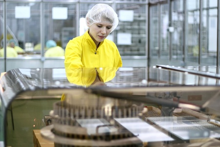 pharmaceutical company: Lab technician working inside a pharmaceutical factory. Stock Photo