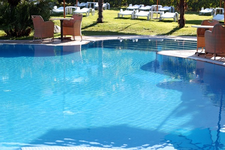 Luxurious open air swimming pool at resort. photo