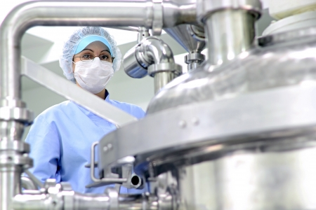 Preparing machine for work in pharmaceutical factory Stock Photo - 11423511