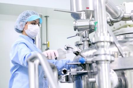 Preparing machine for work in pharmaceutical factory. Selective Focus.