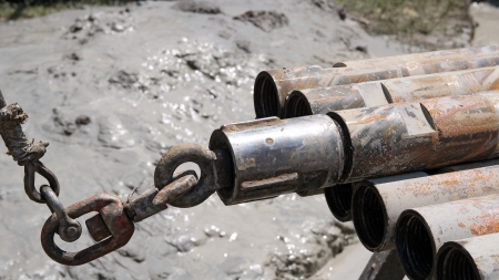 Lifting drill pipe from horizontal position on a drilling rig  photo