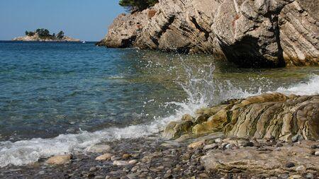 recedes: Waves Smashing Against Rocks