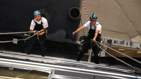 cleaning window:  Two Climbers Working on Heights