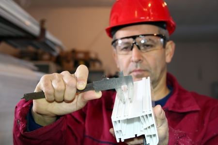 Worker Using a Vernier Caliper Stock Photo