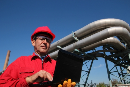 Power Plant Worker With Notebook Computer
