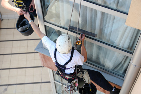 Climbers Washing Windows - Teamwork