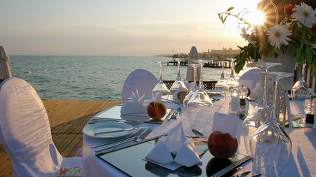 wedding chairs: Romantic Table Setting on Pier at Sunset