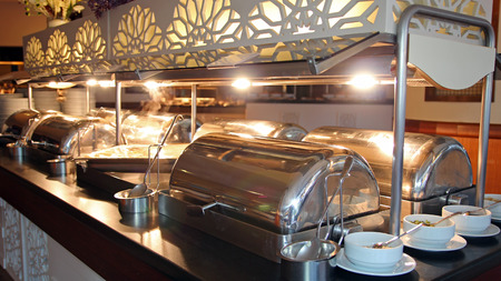 buffet: Many Buffet Heated Trays in Luxury Restaurant Stock Photo