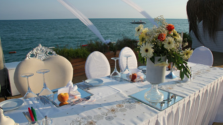 dinnerware: Luxury Table Setting with Candlestick by the Sea