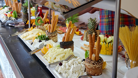 Buffet Catering Food Arrangement on Table.People Serving at Buffet. All inclusive.