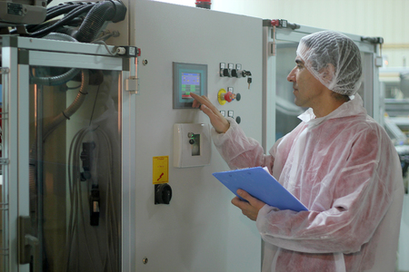 controls: Worker Controls the Sugar Packing Machine