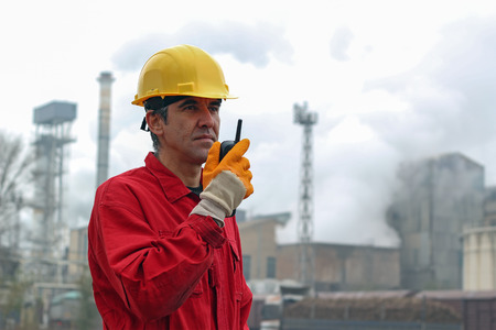 communication: Factory Worker Using Radio Communication Device