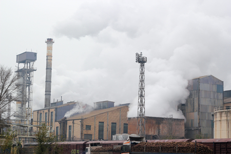 filters: Exterior Of Sugar Refinery. Factory chimneys emitting smoke to the air.