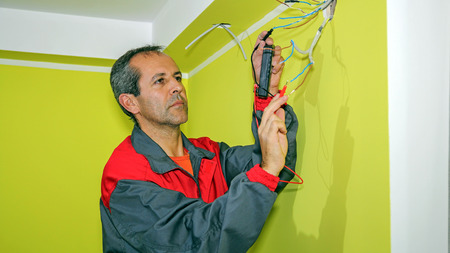 Electrician Measuring With a Digital Multimeter