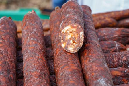 Selling Smoked Sausages at Street Market