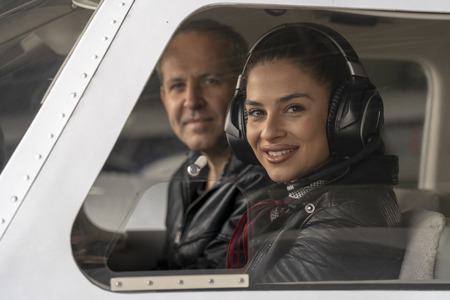 Smiling Female Pilot and Flight Instructor in an Aircraft Cockpit