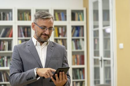 Smiling Middle Aged Man With Tablet Computer