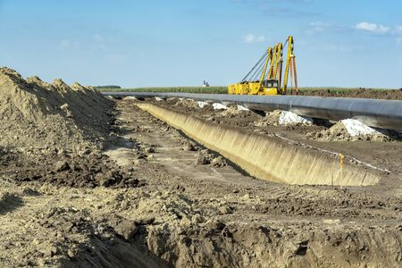 Natural Gas Pipeline Installation and Construction Stock Photo