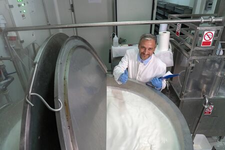 Smiling Dairy Plant Food Technologist Giving Ok Hand Sign Stok Fotoğraf