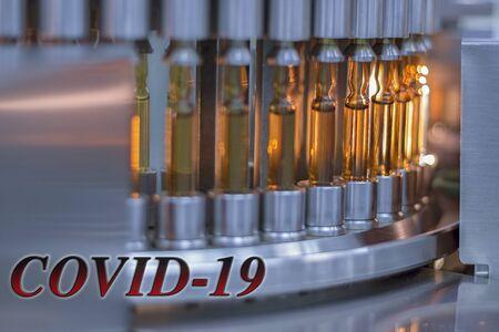 Coronavirus , COVID-19 , Vaccine Testing. Pharmaceutical Automatic Inspection Machine. Stockfoto