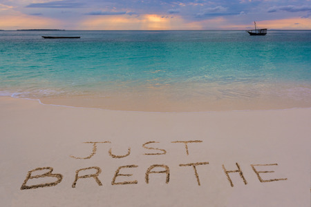 strong message: Just breathe sign in Nungwi north of Zanzibar island.Tanzania.