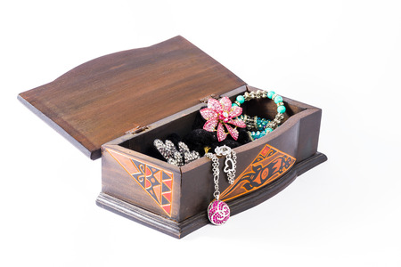 costume jewelry: A view of open wodden carved box with inside costume jewelry. Stock Photo
