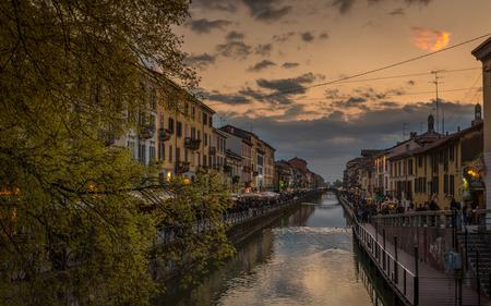 Pictured the canals in Milan Navigli milanesi where thousands of people every night they go for a drink or a simple walk . Stock Photo
