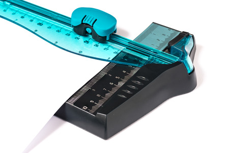 trimmers: In the picture a closeup cutter for paper made of plastic material.