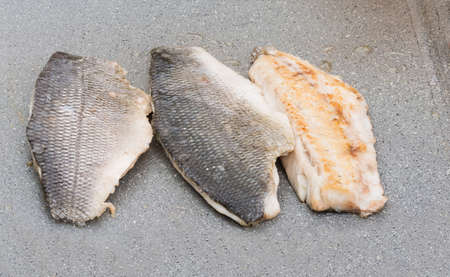 pictured: Pictured three fillets of sea bream cooked on the grill